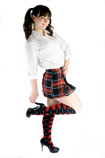 Schoolgirl with red black argyle knee socks