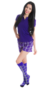 girl wearing purple plaid shorts and high socks