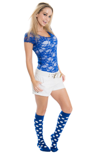 girl wearing white shorts, royal blue top and polka dot high socks